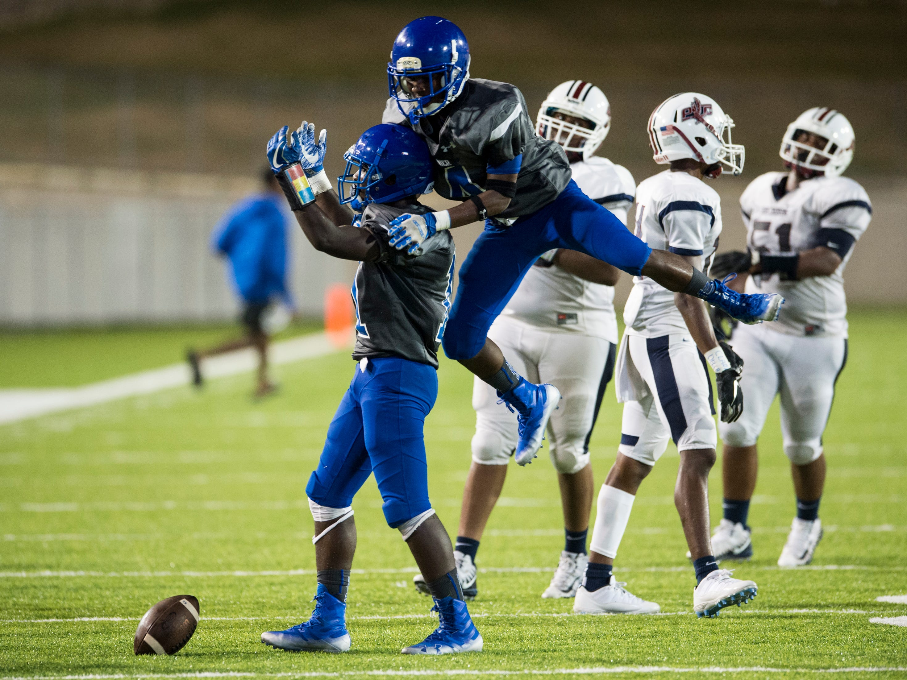 Lanier's Charles Armstrong (11) and Lanier's Jecorious Smith (4) celebrate after Armstorng's game ending interception at Cramton Bowl in Montgomery, Ala., on Friday, Sept. 21, 2018. Lanier defeated Park Crossing 35-28.