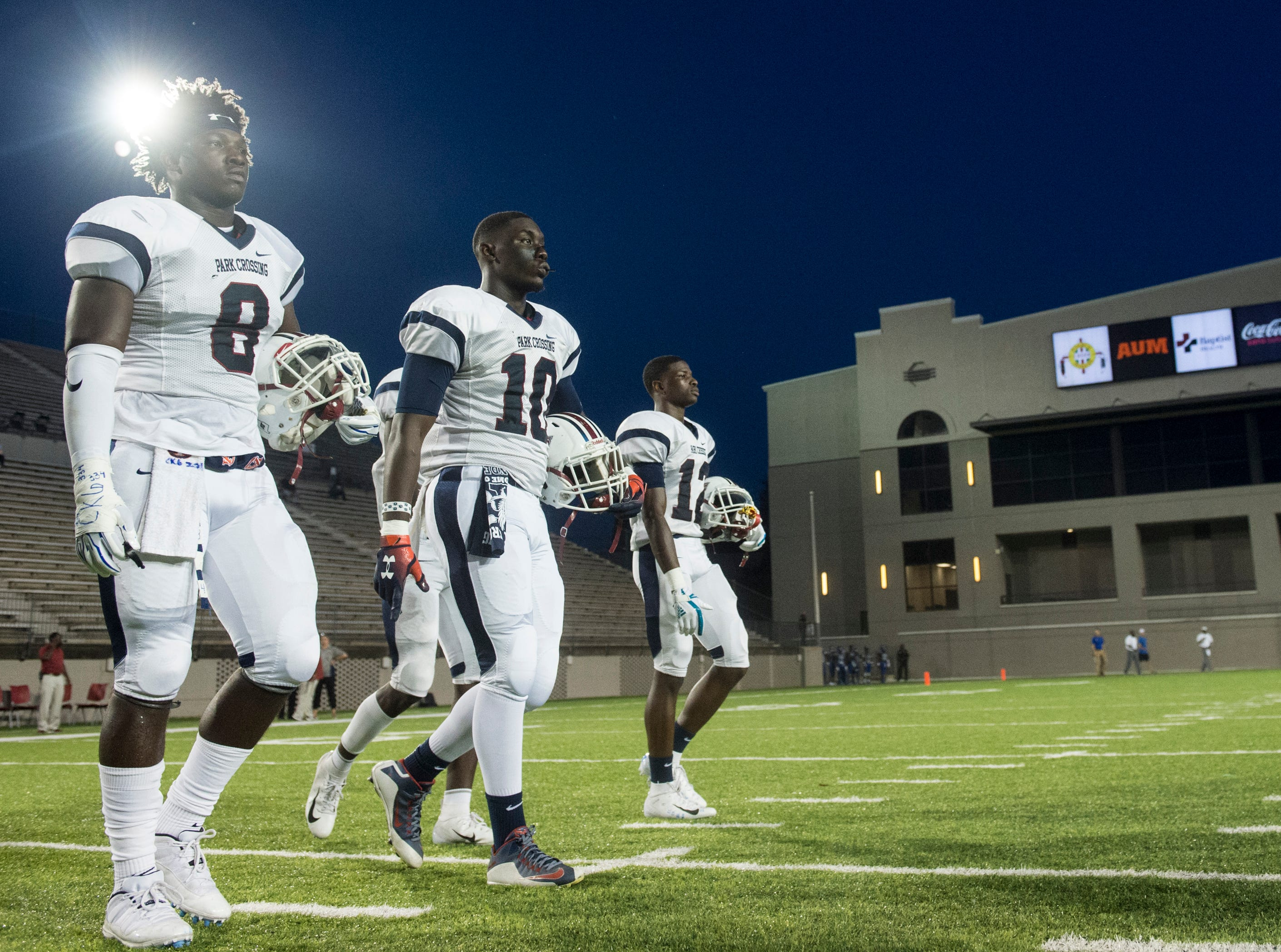 Park Crossing team captains walk to midfield for the coin toss at Cramton Bowl in Montgomery, Ala., on Friday, Sept. 21, 2018. Lanier leads Park Crossing 14-7 at halftime.