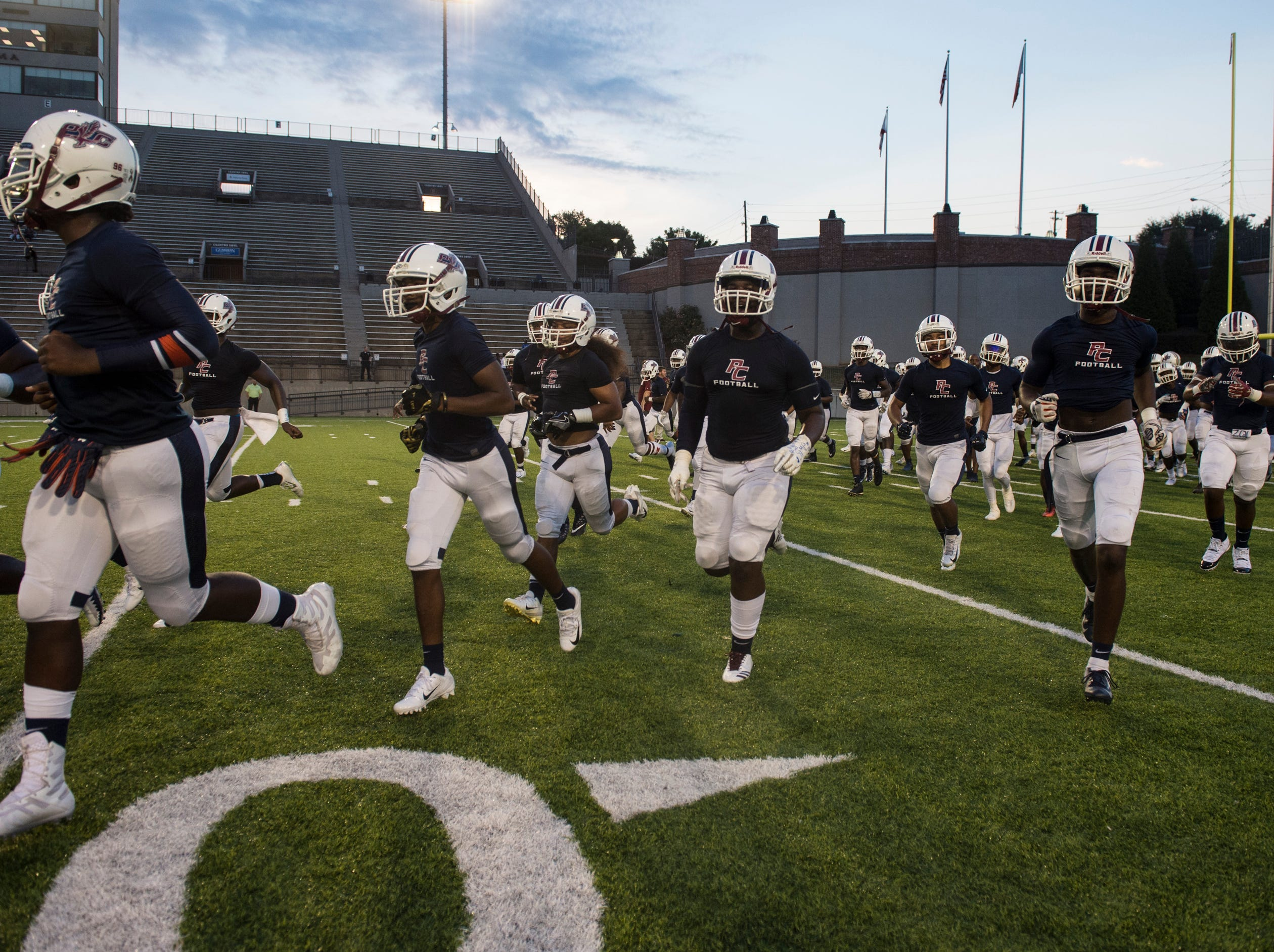 Park Crossing players take the field for warm ups at Cramton Bowl in Montgomery, Ala., on Friday, Sept. 21, 2018. Lanier leads Park Crossing 14-7 at halftime.