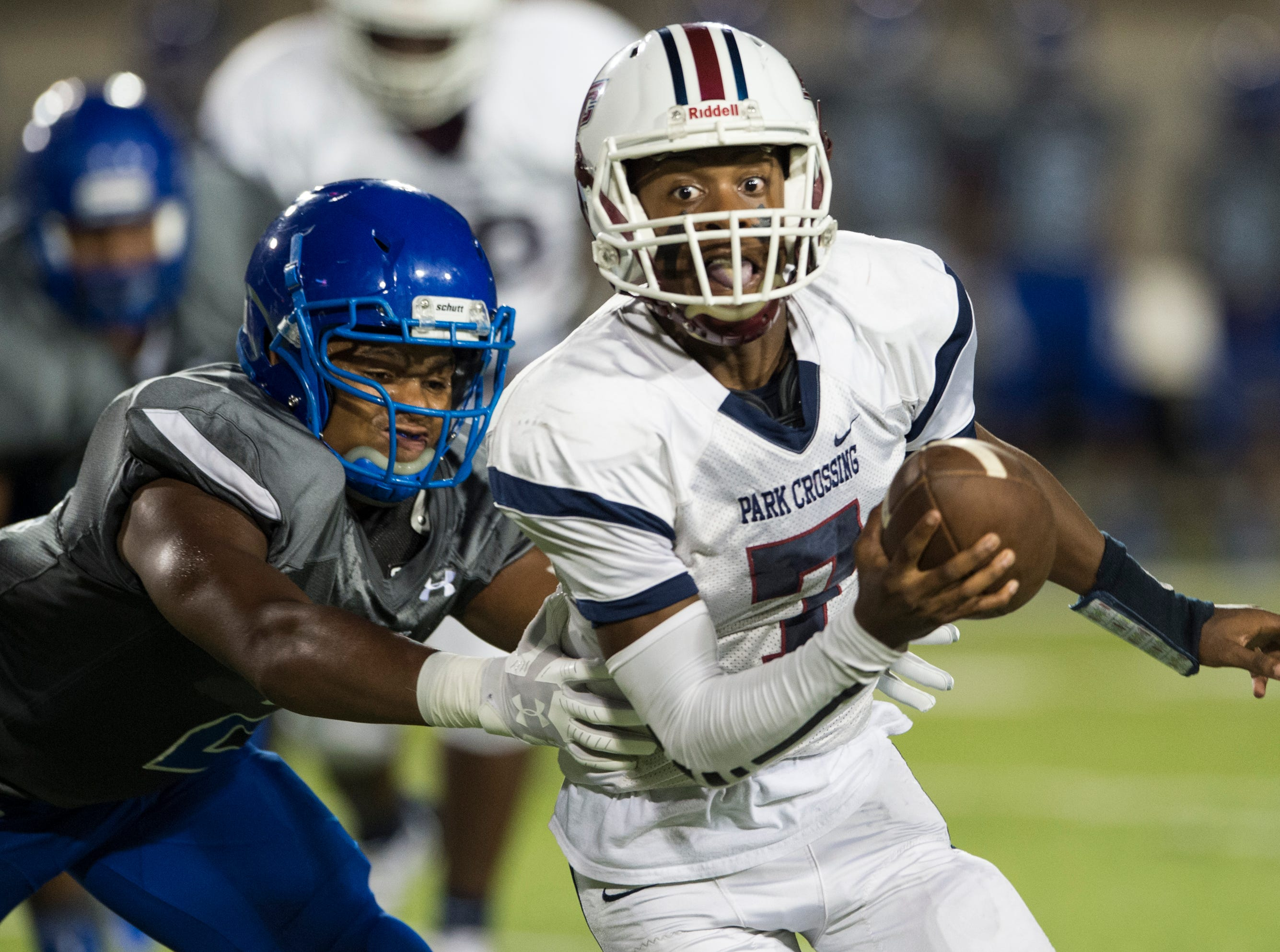 Park Crossing's Trevor Robinson (7) is taken down by Lanier's Michael Artis (2) at Cramton Bowl in Montgomery, Ala., on Friday, Sept. 21, 2018. Lanier leads Park Crossing 14-7 at halftime.