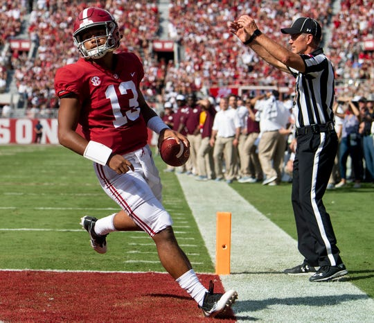 Alabama quarterback Tua Tagovailoa (13) strolls into the end zone for a touchdown against Texas A&M in first half action in Tuscaloosa, Ala., on Saturday September 22, 2018.