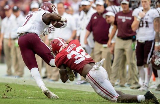Alabama linebacker Anfernee Jennings (33) stops Texas A&M running back Jashaun Corbin (7) in second half action in Tuscaloosa, Ala., on Saturday September 22, 2018.