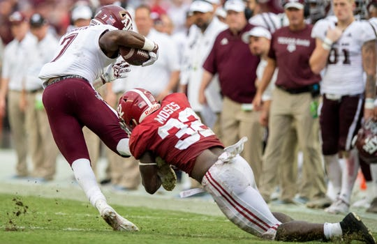 Alabama linebacker Anfernee Jennings (33) stops Texas A&M running back Jashaun Corbin (7) in second half action in Tuscaloosa, Ala., on Saturday September 22, 2018.
