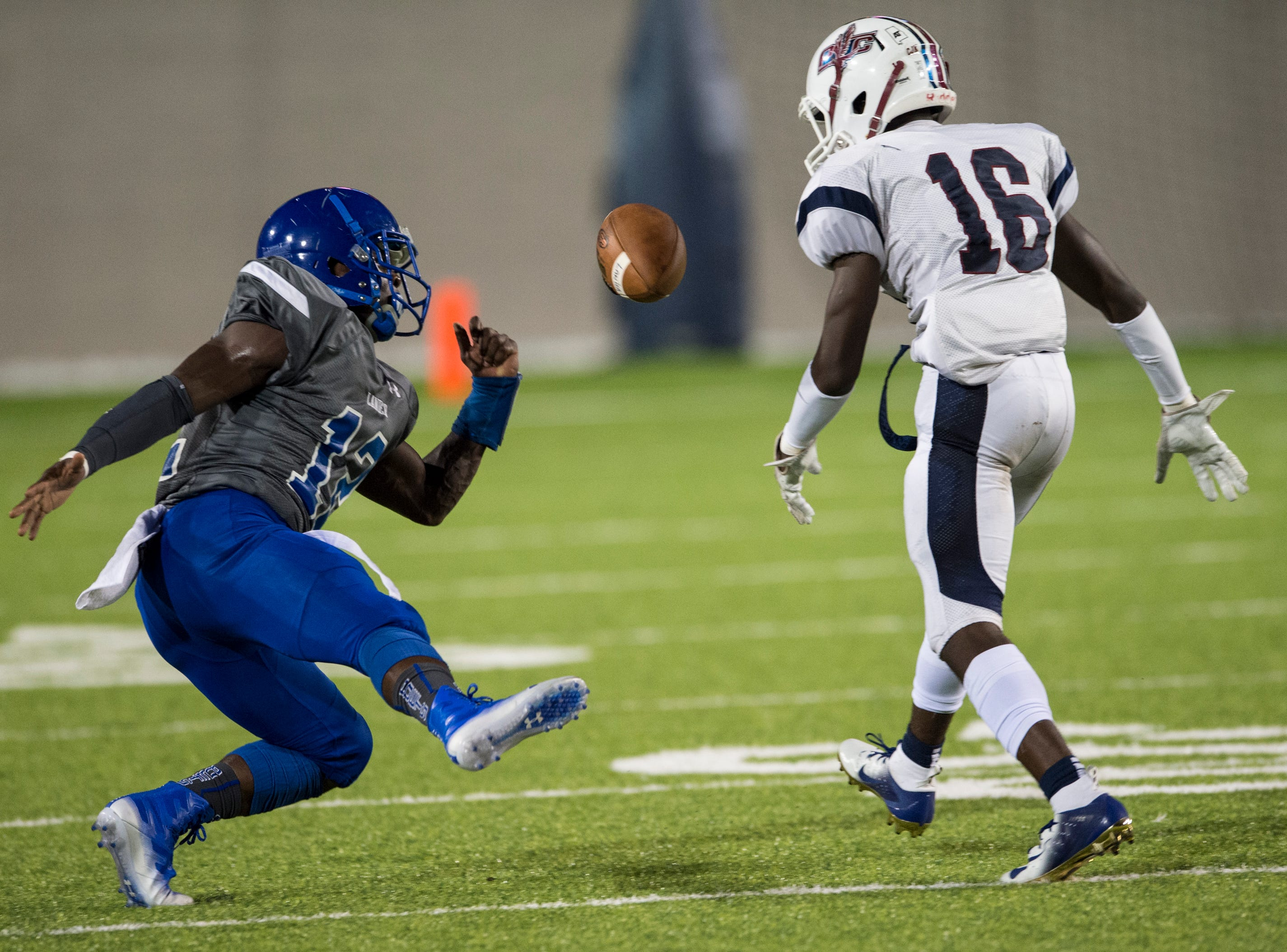 Lanier's Noah Hart (12) pulls down a tipped pass as he falls back defended by Park Crossing's Jaylen Carthen (16) at Cramton Bowl in Montgomery, Ala., on Friday, Sept. 21, 2018. Lanier leads Park Crossing 14-7 at halftime.