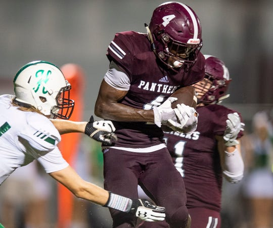 Elmore County's Deundre Patrick intercepts a pass against Holtville in Eclectic, Ala., on Friday September 21, 2018.
