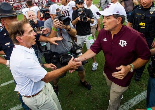 Alabama head coach Nick Saban and Texas A&M head coach Jimbo Fisher meet at midfield following their game in Tuscaloosa, Ala., on Saturday September 22, 2018.