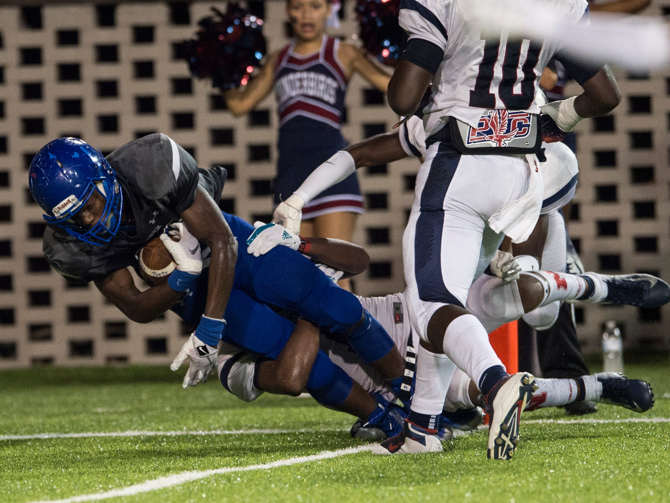 Lanier's Jacory Merritt (15) falls into the end zone for a touchdown against Park Crossing at Cramton Bowl in Montgomery, Ala., on Friday, Sept. 21, 2018. Lanier defeated Park Crossing 35-28.