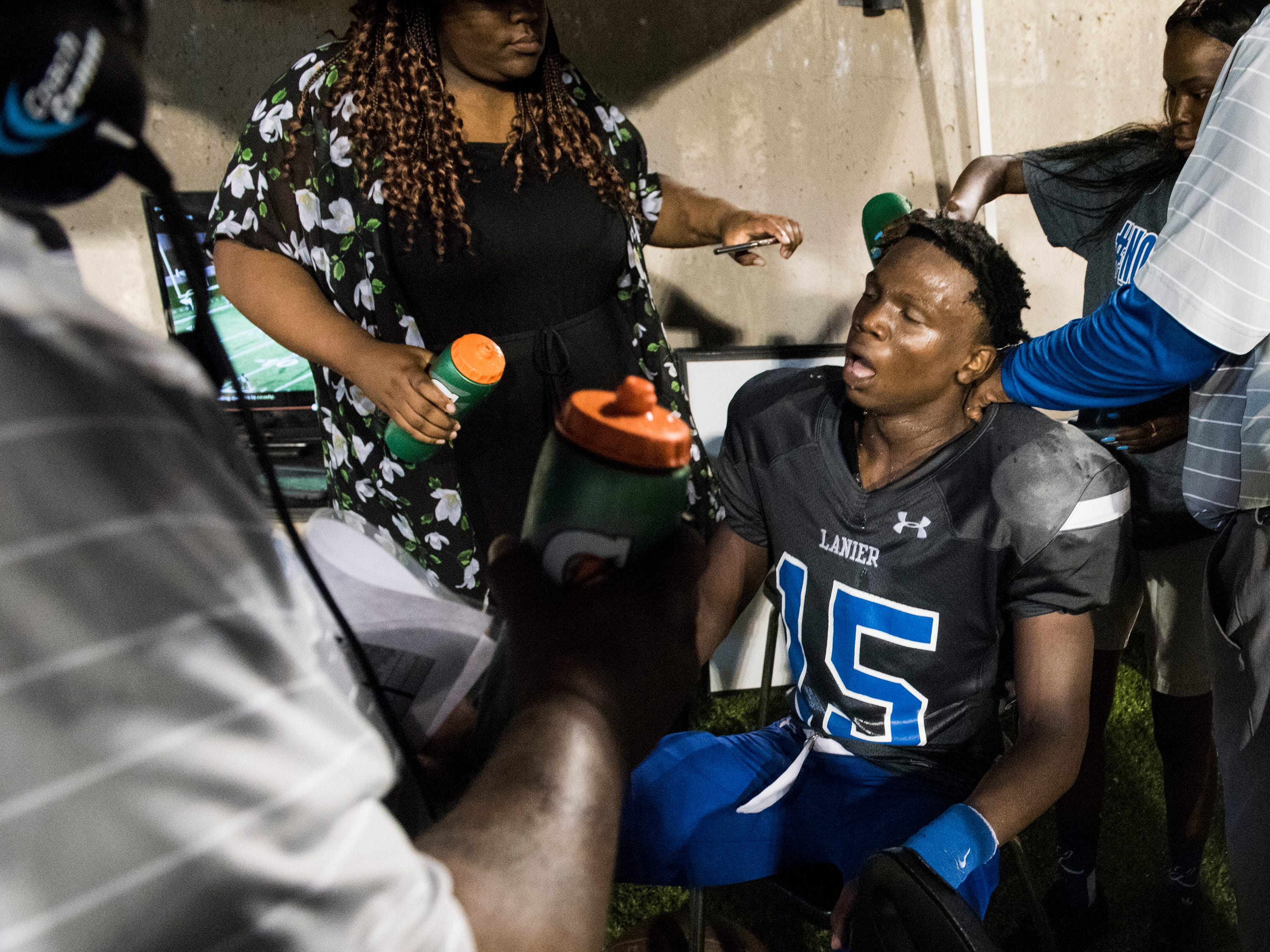 Lanier's Jacory Merritt (15) takes a much needed break after scoring a touchdown against Park Crossing at Cramton Bowl in Montgomery, Ala., on Friday, Sept. 21, 2018. Lanier defeated Park Crossing 35-28.