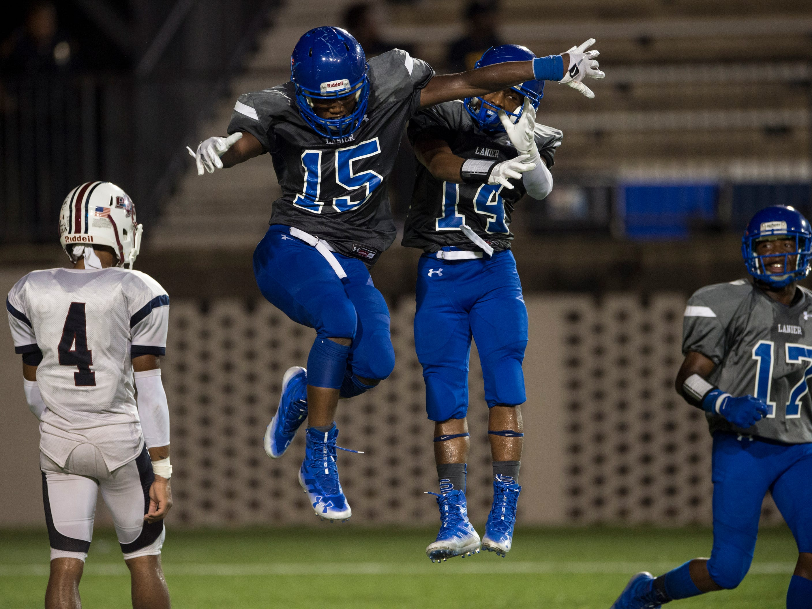 Lanier's Jacory Merritt (15) celebrates with Anthony Shackelford (14) after Merritt's touchdown run against Park Crossing at Cramton Bowl in Montgomery, Ala., on Friday, Sept. 21, 2018. Lanier defeated Park Crossing 35-28.