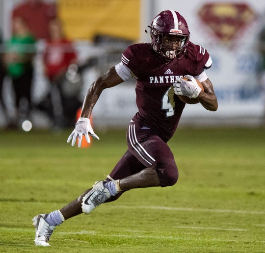 Elmore County's Deundre Patrick (4) carries against Holtville in Eclectic, Ala., on Friday September 21, 2018.