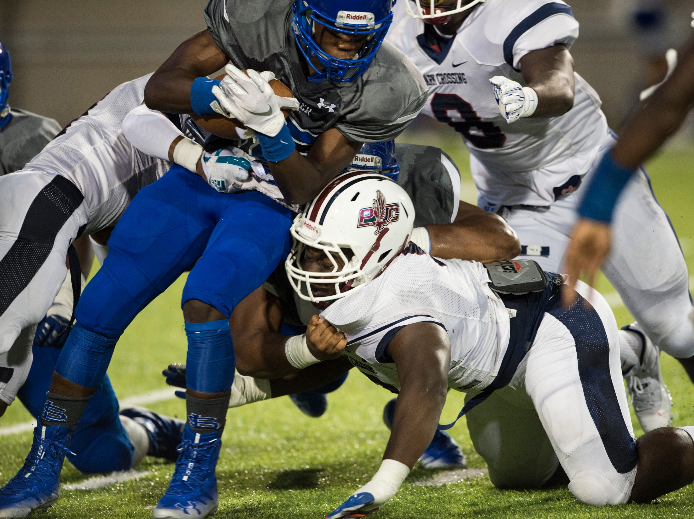 Lanier's Jacory Merritt (15) is wrapped up by a swarm of Park Crossing defenders at Cramton Bowl in Montgomery, Ala., on Friday, Sept. 21, 2018. Lanier leads Park Crossing 14-7 at halftime.