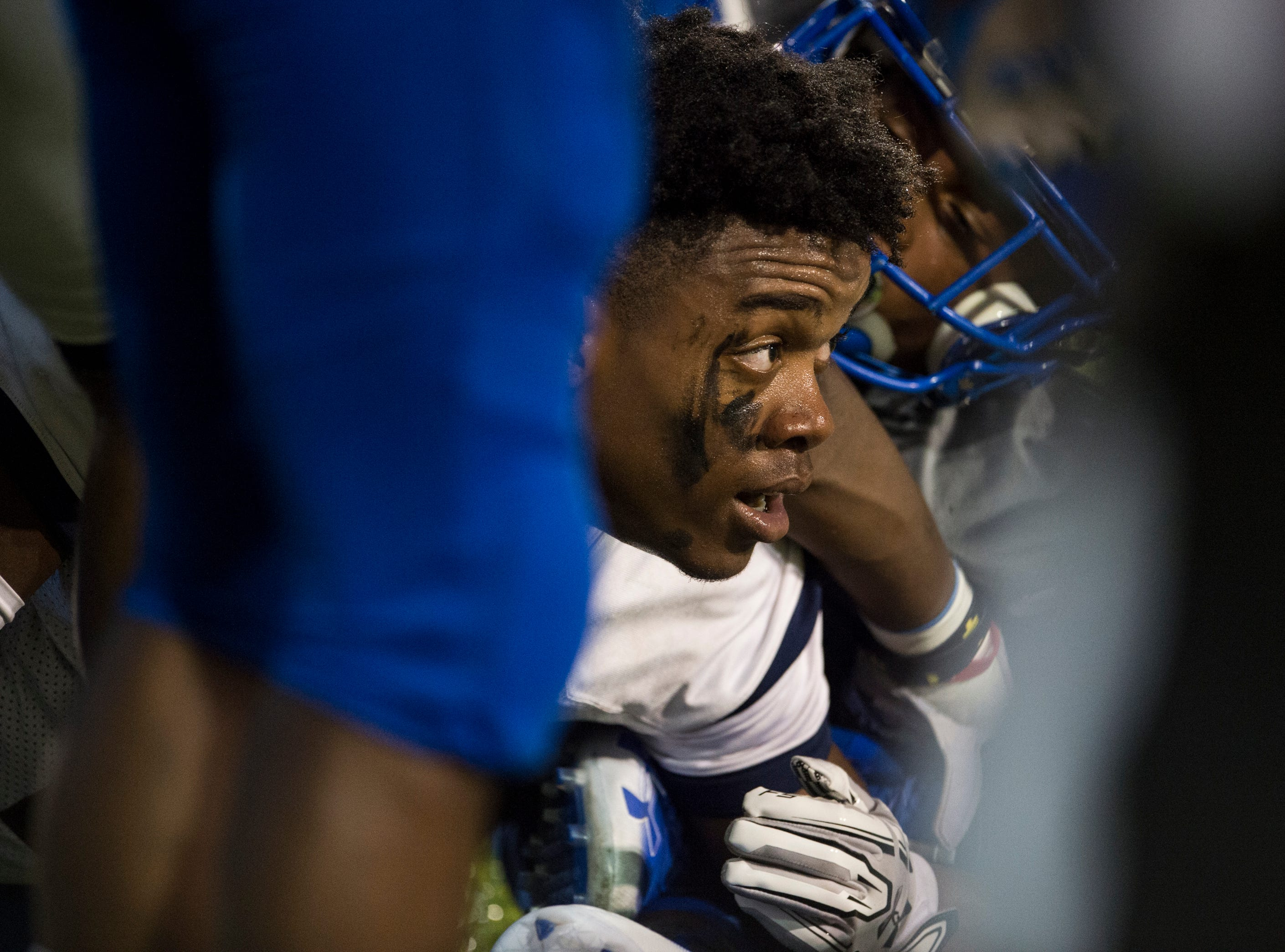 Park Crossing's Trevor Robinson (7) looks up after losing his helmet in a dog pile as he pushes in for a touchdown at Cramton Bowl in Montgomery, Ala., on Friday, Sept. 21, 2018. Lanier leads Park Crossing 14-7 at halftime.