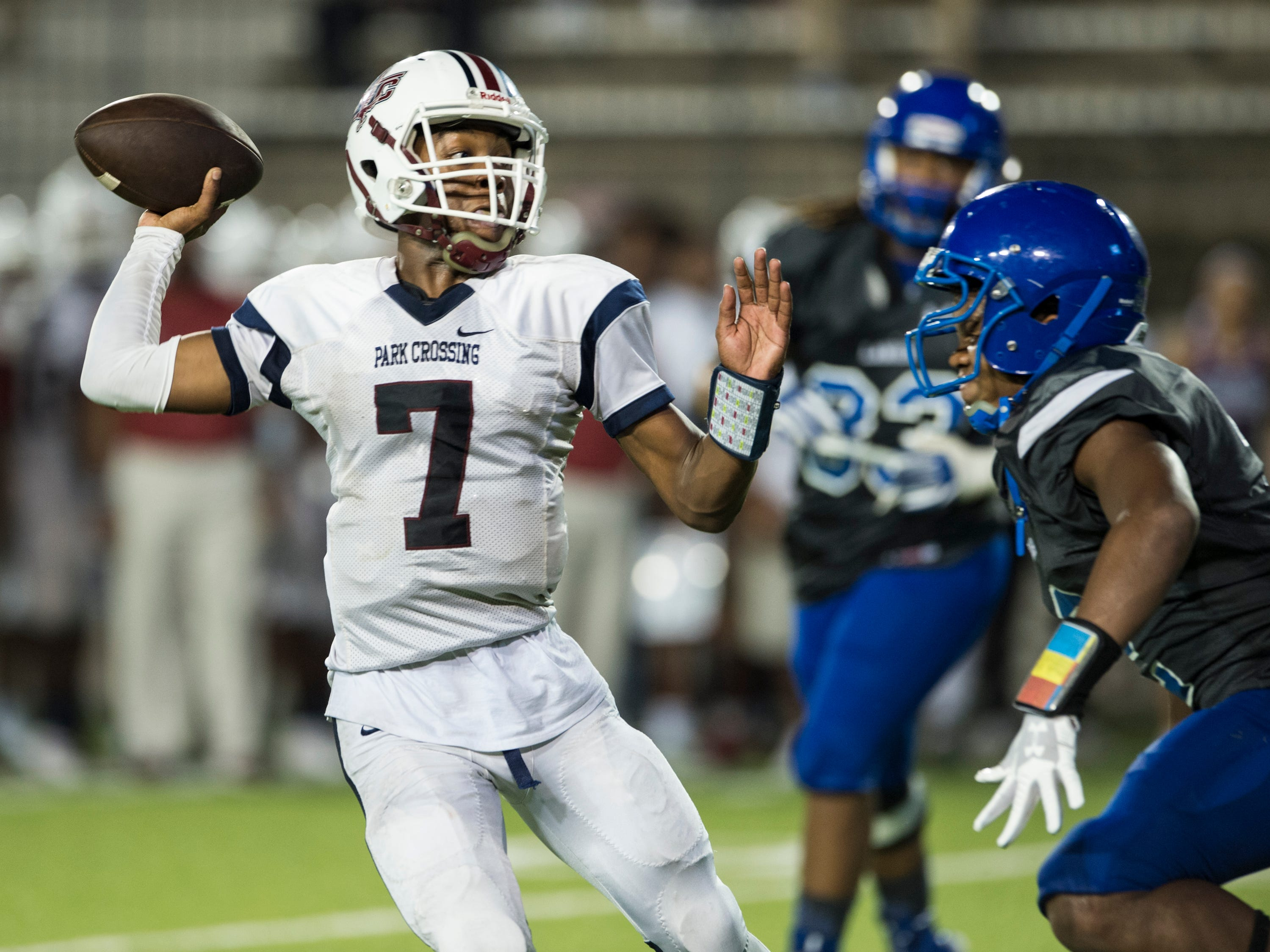 Park Crossing's Trevor Robinson (7) throws the ball down the field at Cramton Bowl in Montgomery, Ala., on Friday, Sept. 21, 2018. Lanier defeated Park Crossing 35-28.