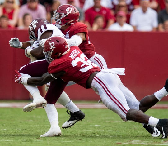 Alabama linebackers Dylan Moses (32) and Christian Miller (47) stop Texas A&M running back Jashaun Corbin (7) in second half action in Tuscaloosa, Ala., on Saturday September 22, 2018.