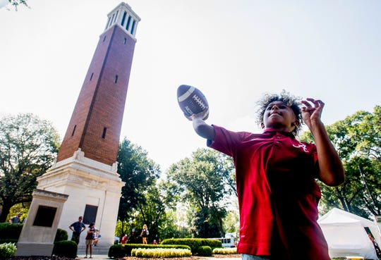 Kaden Watkin, of Decatur, throws a football near Denny Chimes before the Alabama vs. Texas A&M game in Tuscaloosa, Ala., on Saturday September 22, 2018.
