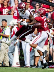 Alabama defensive back Patrick Surtain, II, (2) breaks up a pass intended for Texas A&M wide receiver Kendrick Rogers (13) In first half action in Tuscaloosa, Ala., on Saturday September 22, 2018.