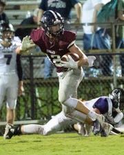 Academy's William Robertson runs the ball late in the second quarter against Prattville Christian.