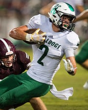 Holtville's Drew Nobles (2) against Elmore County's Hayden Holton (10) in Eclectic, Ala., on Friday September 21, 2018.