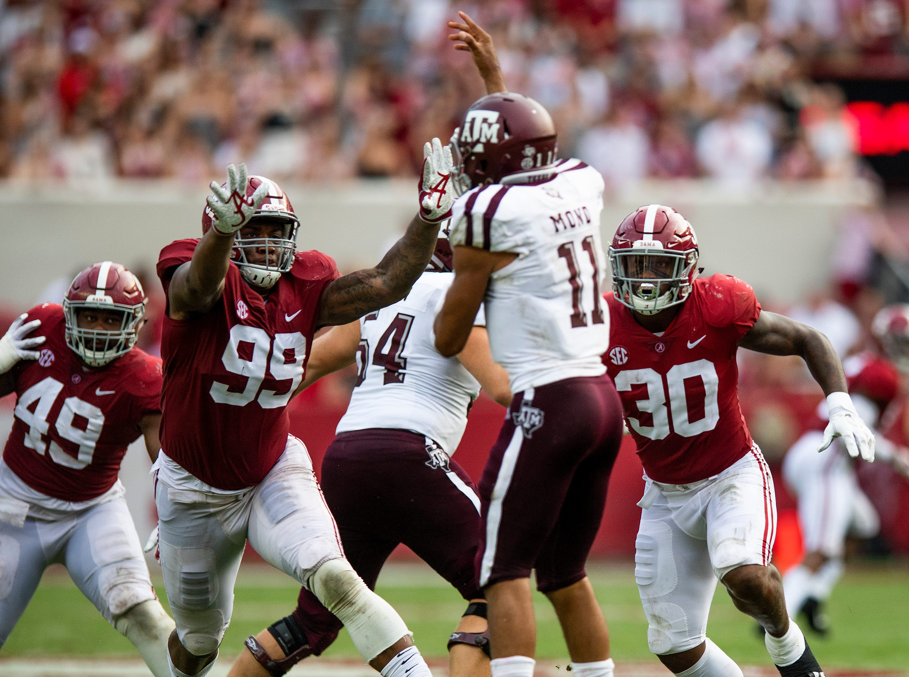 Alabama defensive lineman Raekwon Davis (99) and linebacker Mack Wilson (30) pressure Texas A&M quarterback Kellen Mond (11) in second half action in Tuscaloosa, Ala., on Saturday September 22, 2018.