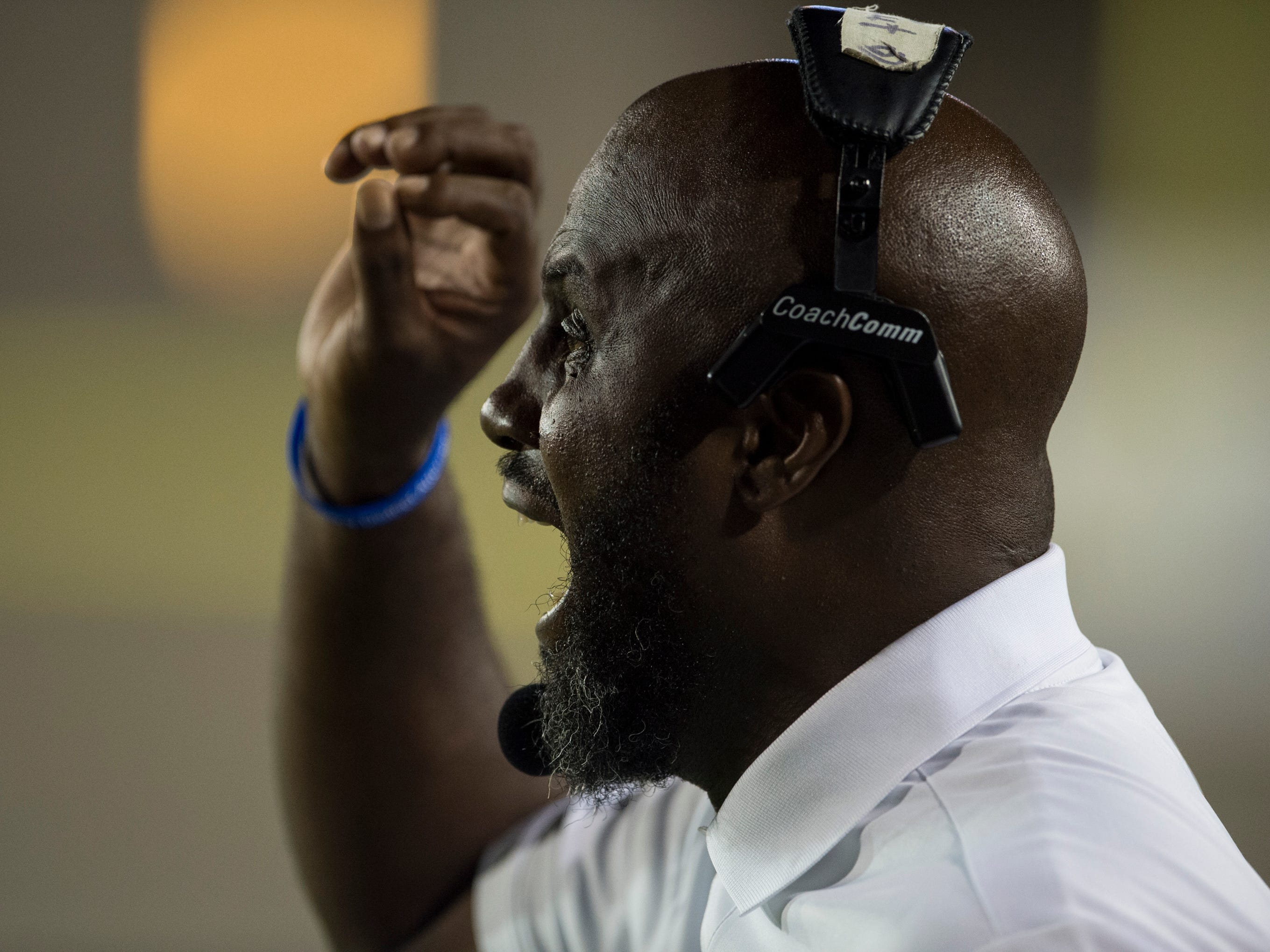 Lanier head coach Marvin Cunningham yells at his team from the sideline at Cramton Bowl in Montgomery, Ala., on Friday, Sept. 21, 2018. Lanier defeated Park Crossing 35-28.