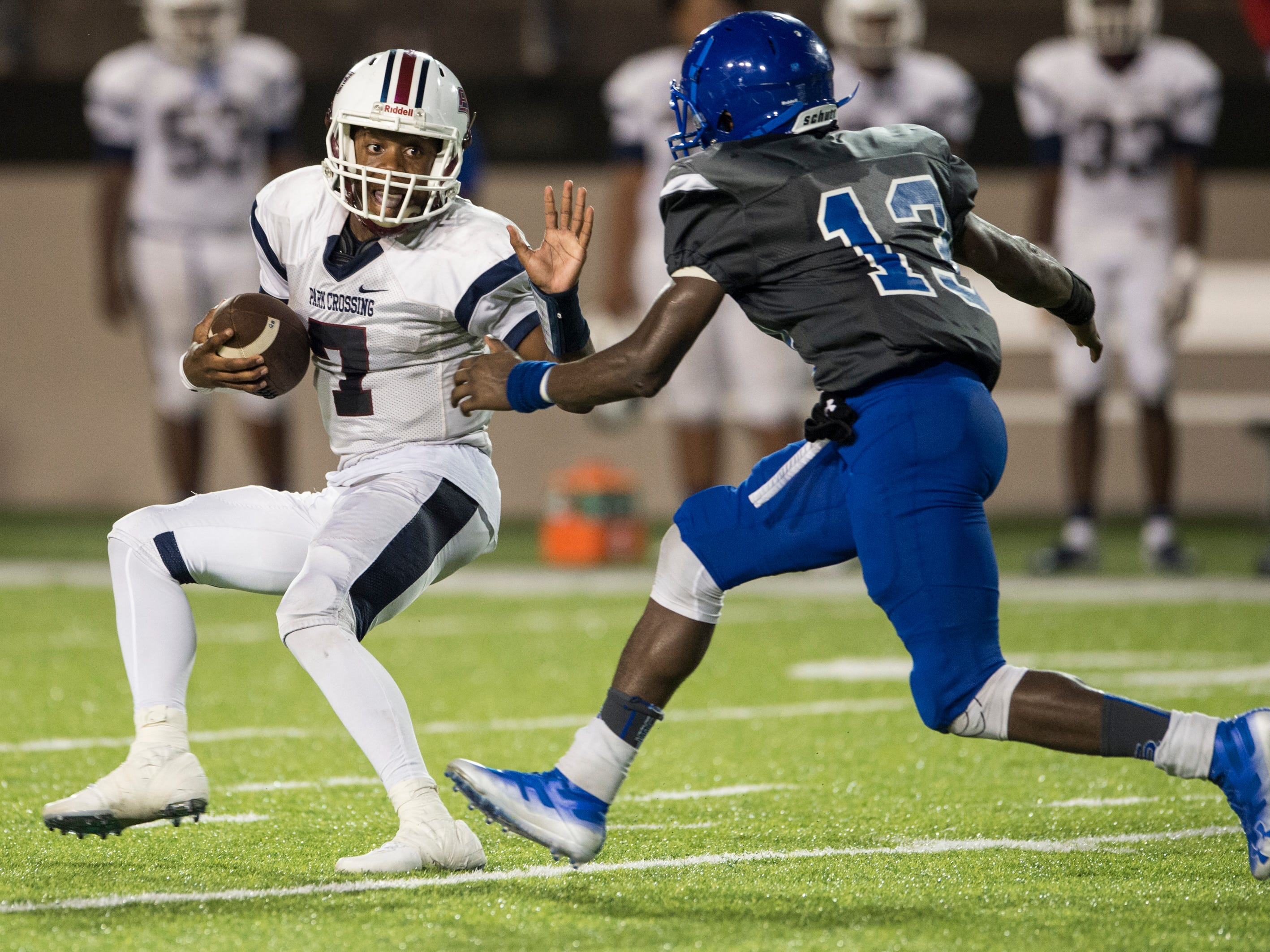 Park Crossing's Trevor Robinson (7) is sacked by Lanier's Alazavia Berry (13) at Cramton Bowl in Montgomery, Ala., on Friday, Sept. 21, 2018. Lanier defeated Park Crossing 35-28.