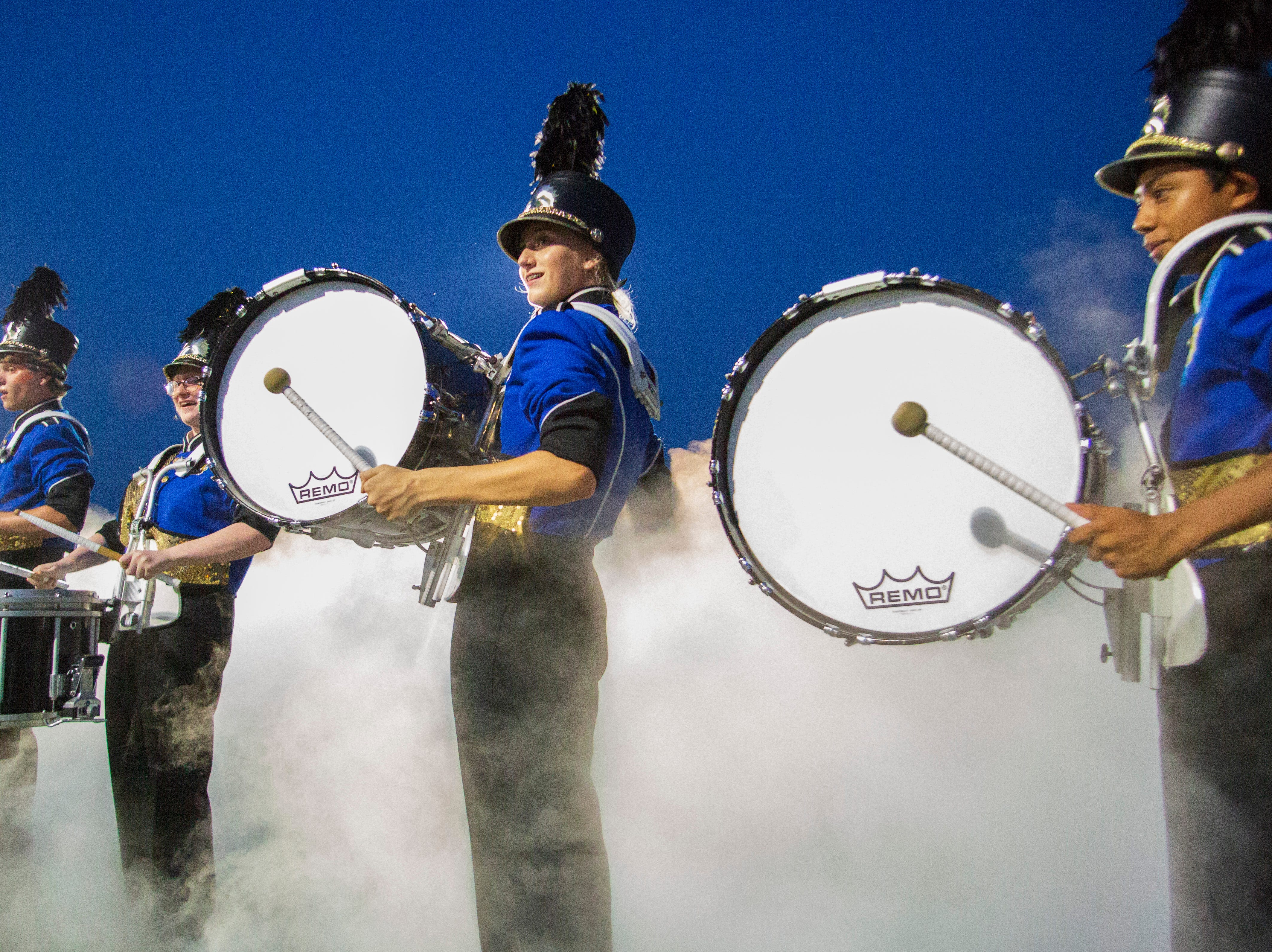 A cloud swirls around the Montgomery Catholic band as they welcome the team to the field with a song.