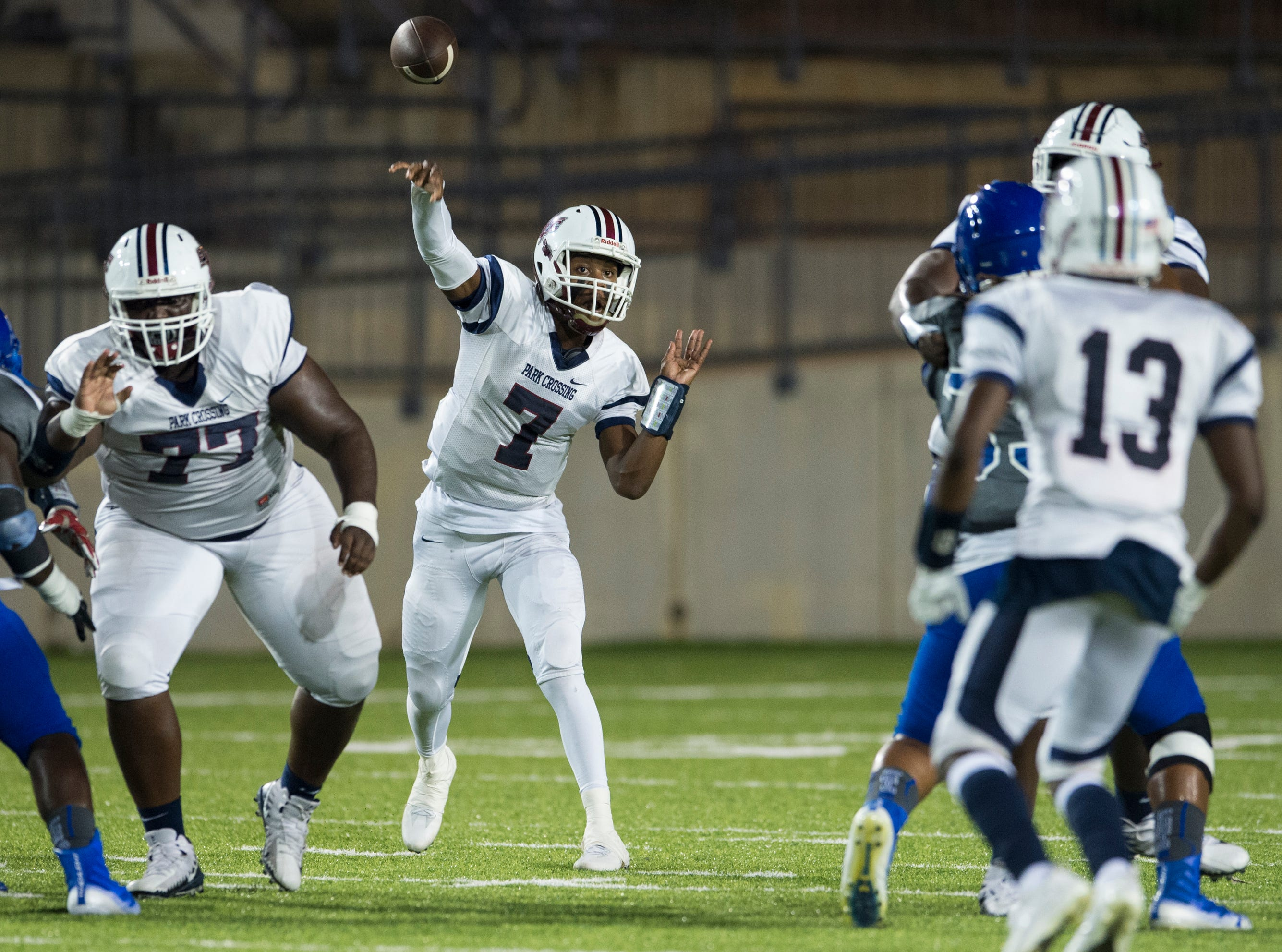 Park Crossing's Trevor Robinson (7) throws the ball down field at Cramton Bowl in Montgomery, Ala., on Friday, Sept. 21, 2018. Lanier leads Park Crossing 14-7 at halftime.