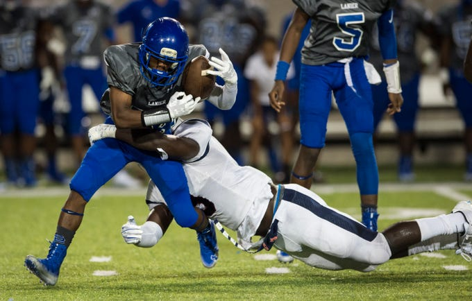 Park Crossing's Marcus Harris (8) blows up the backfield and tackles Lanier's Anthony Shackelford (14) at Cramton Bowl in Montgomery, Ala., on Friday, Sept. 21, 2018. Lanier defeated Park Crossing 35-28.