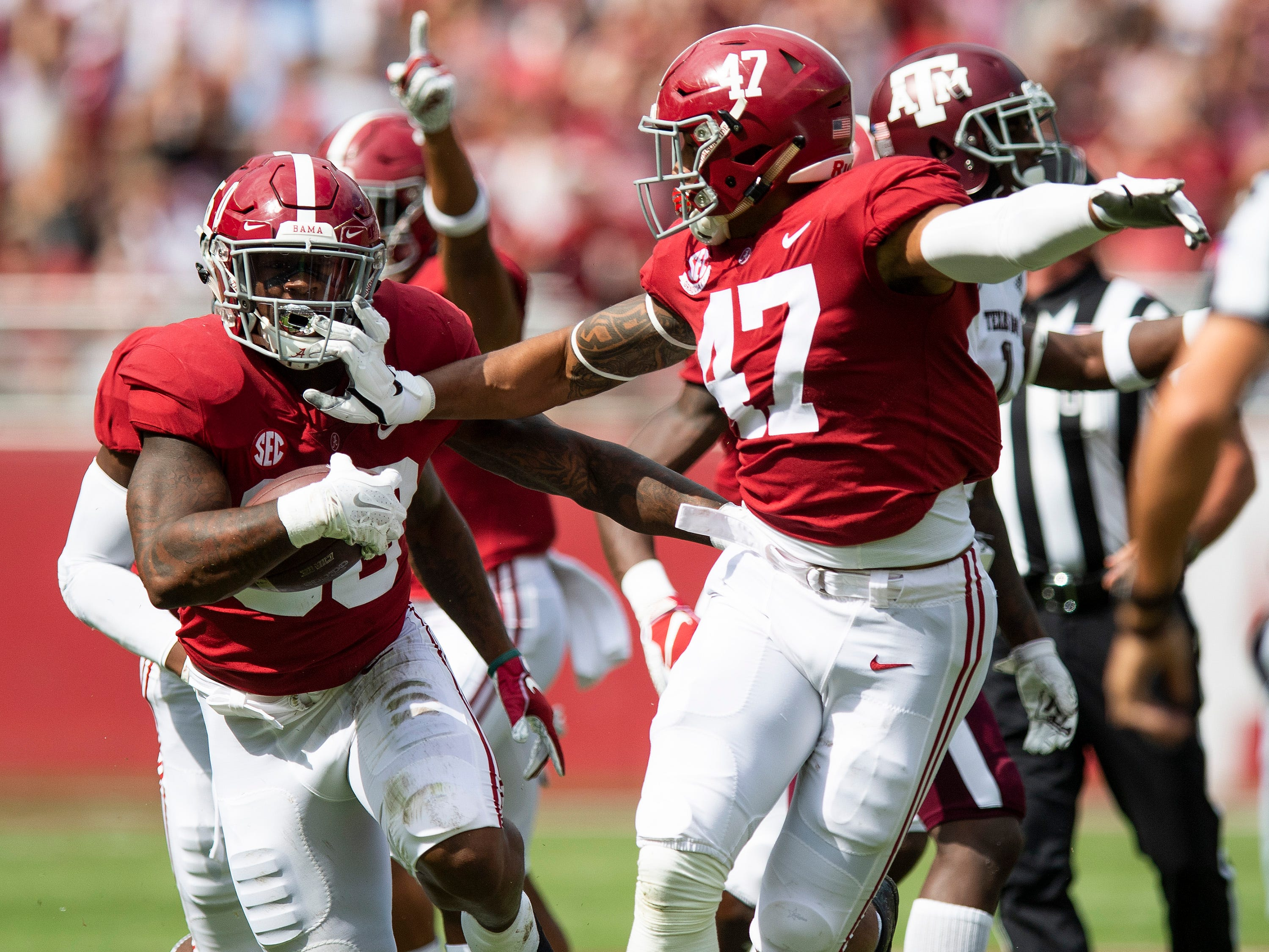 Alabama linebacker Mack Wilson (30) and linebacker Christian Miller (47) celebrate Wilson's interception against Texas A&M In first half action in Tuscaloosa, Ala., on Saturday September 22, 2018.