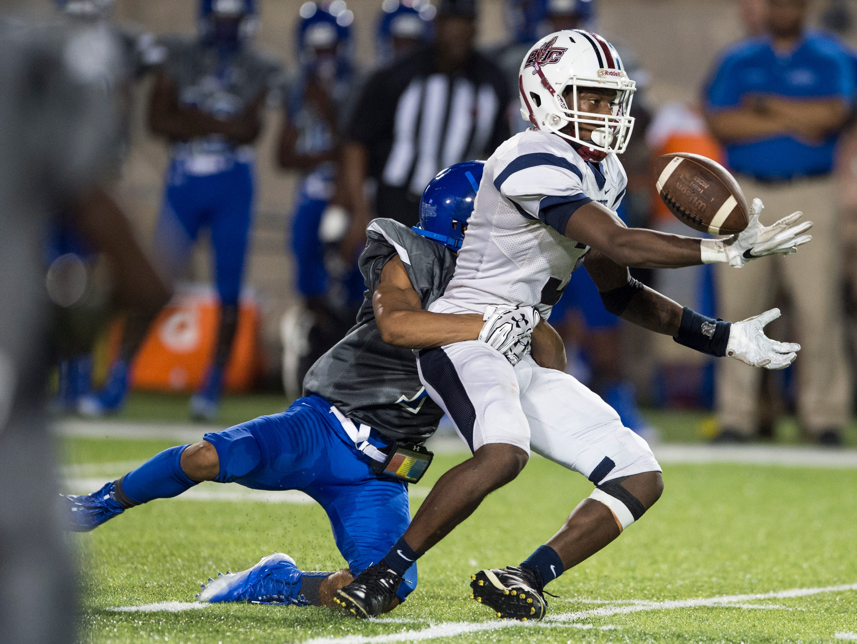 Park Crossing's Tremaine Osborne (3) can't quite hold on to the ball defended by Lanier's Keldrick Jacobs (1) at Cramton Bowl in Montgomery, Ala., on Friday, Sept. 21, 2018. Lanier leads Park Crossing 14-7 at halftime.