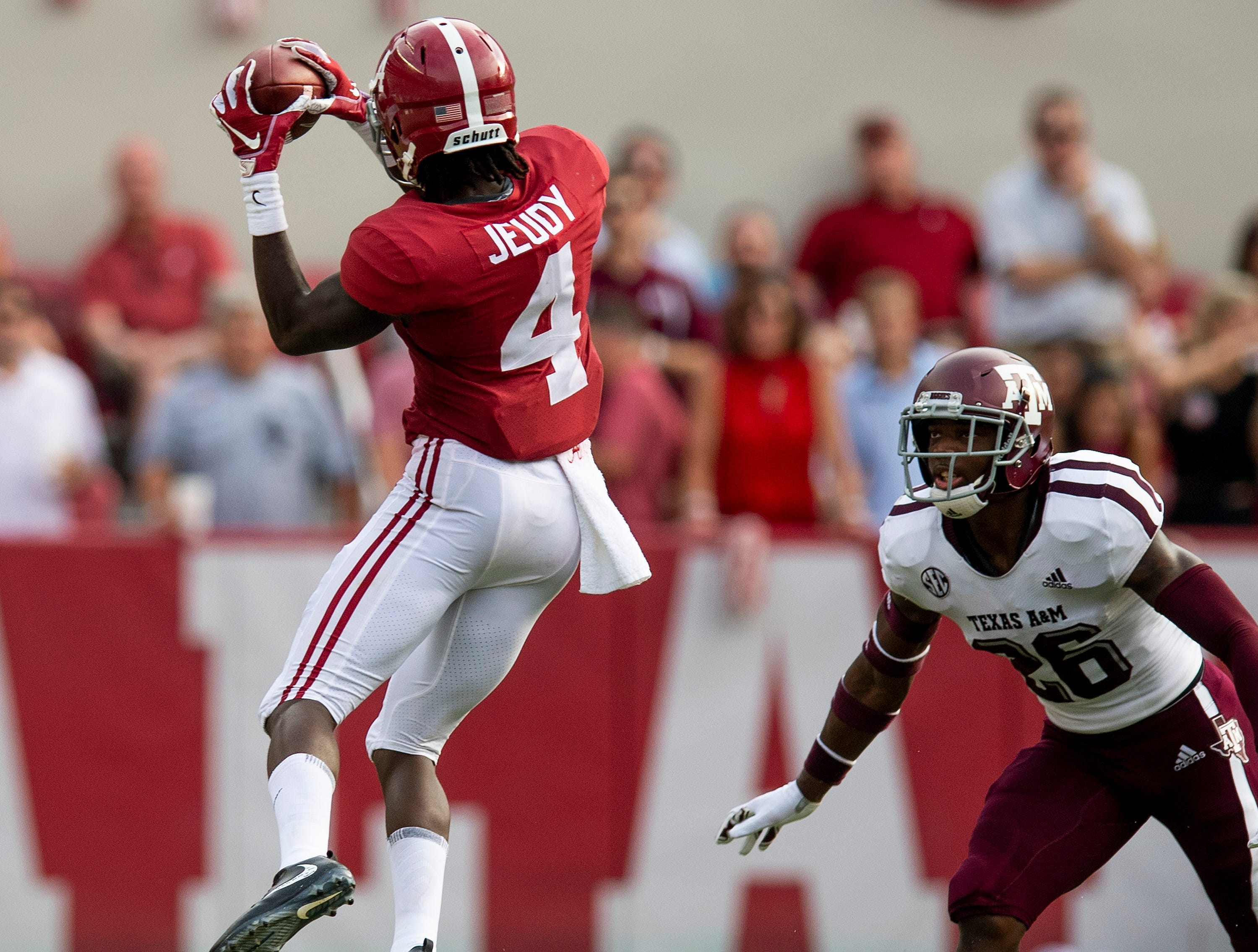 Alabama wide receiver Jerry Jeudy (4) catches a pass against Texas A&M defensive back Deshawn Capers-Smith (26) in second half action in Tuscaloosa, Ala., on Saturday September 22, 2018.