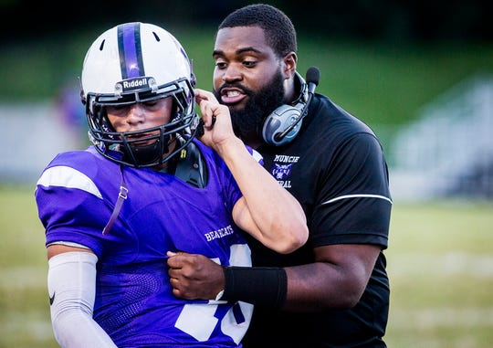 Central assistant coach Darrick Lee talks with a player during the Bearcats' game against Kokomo this season.