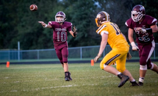 Wes-Del's Eric Harlan throws the ball at Wes-Del High School for the Harvest Helmet Classic between Wes-Del and Monroe Central in 2018.