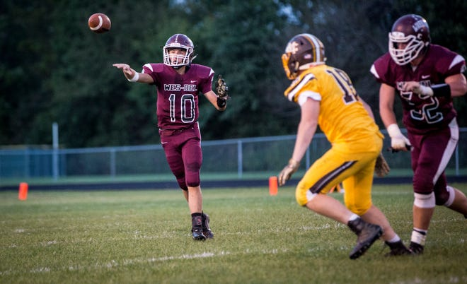Wes-Del's Eric Harlan throws the ball at Wes-Del High School for the Harvest Helmet Classic between Wes-Del and Monroe Central. Monroe Central won the game 34-8.