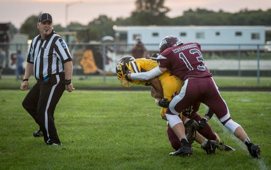 FILE -- Wes-Del's Caeden McClaughry makes a tackle on a Monroe Central defender during a game at Wes-Del High School in 2018.