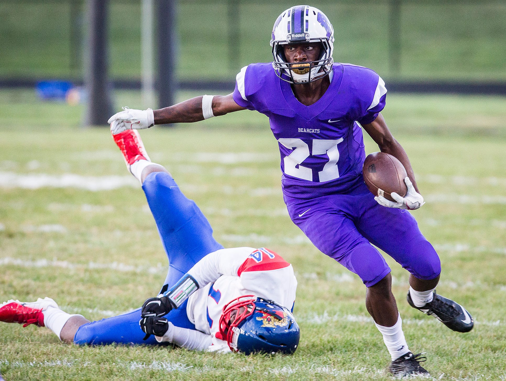 Central's Damarius Pegues slips past Kokomo's defense during their game at Central Friday, Sept. 21, 2018.