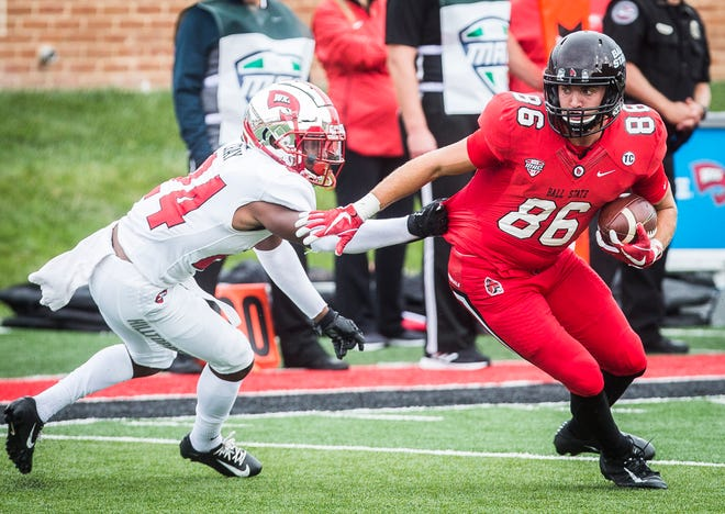 Ball State's Riley Miller fights against Western Kentucky's defense during their game at Scheumann Stadium Saturday, Sept. 22, 2018.