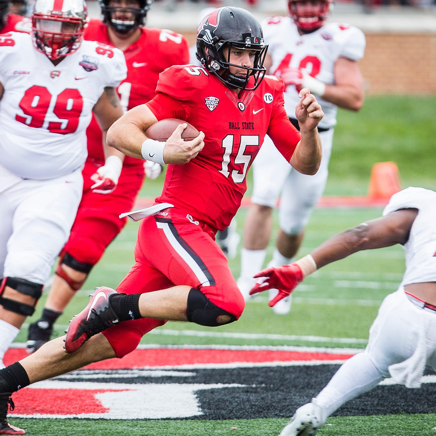 Ball State's Riley Neal runs the ball against Western Kentucky's defense during their game at Scheumann Stadium Saturday, Sept. 22, 2018.