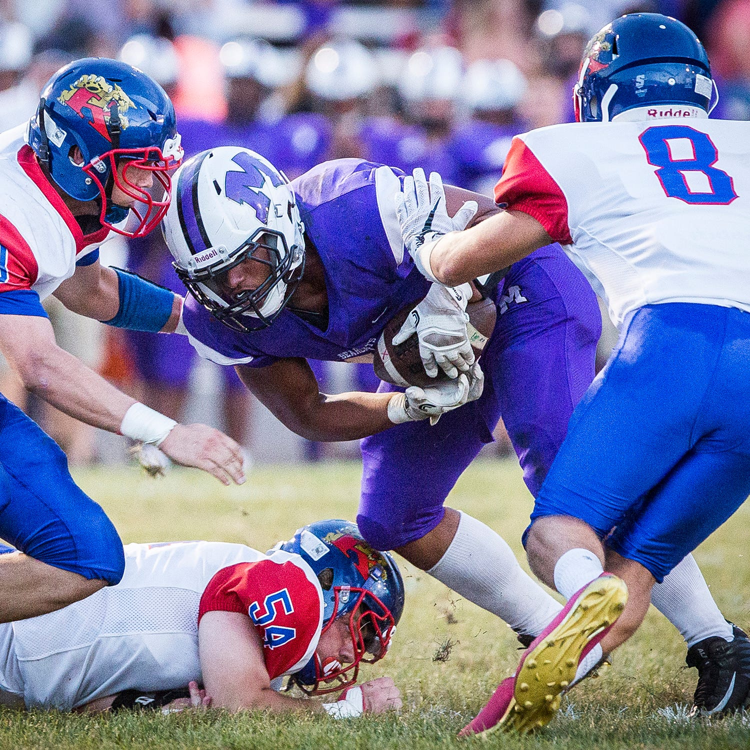 Central's Adrian Leavell fights past Kokomo's defense during their game at Central Friday, Sept. 21, 2018.