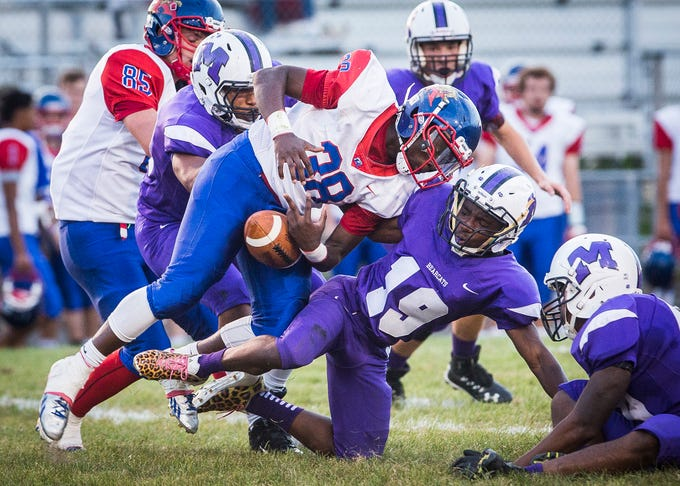 Central's Da'marion Walker stops a run by Kokomo during their game at Central Friday, Sept. 21, 2018.