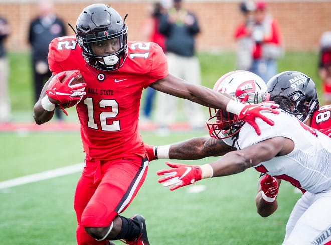 Ball State's Justin Hall slips past Western Kentucky's defense during their game at Scheumann Stadium Saturday, Sept. 22, 2018.