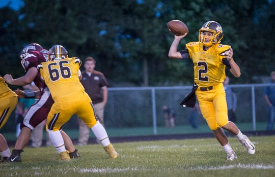Monroe Central's Jackson Ullom throws on the run against Wes-Del this season. Ullom helped lead the Golden Bears to their second straight sectional title.