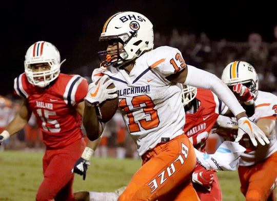 Blackman's Trey Knox (13) runs the ball against Oakland on Friday, Sept. 21, 2018, at Oakland.