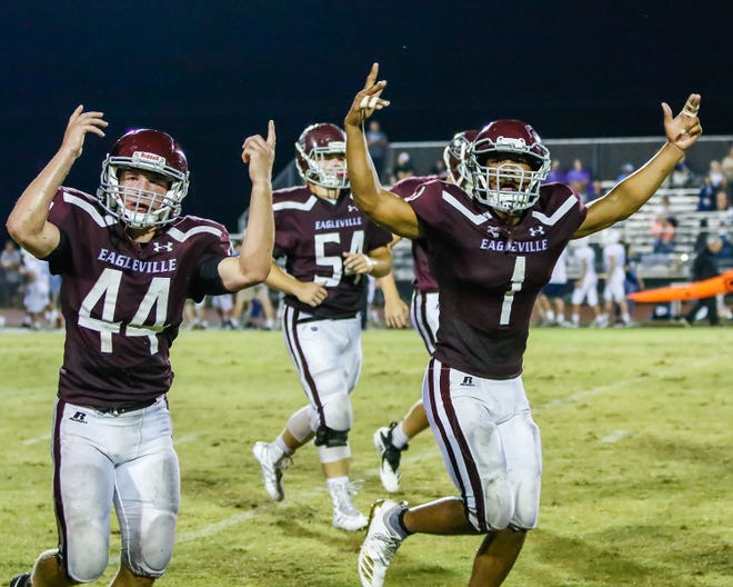 Eagleville's Wyatt McLemore, 44, and Sekwon Park, 1, work the Eagleville sideline during a recent game. The Eagles could shake up the Region 5-2A standings with a win over Columbia Academy Friday.