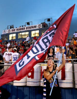 Oakland senior Olivia Perry practices waving an Oakland flag before the start of the game against Blackman on Friday, Sept. 21, 2018, at Oakland.