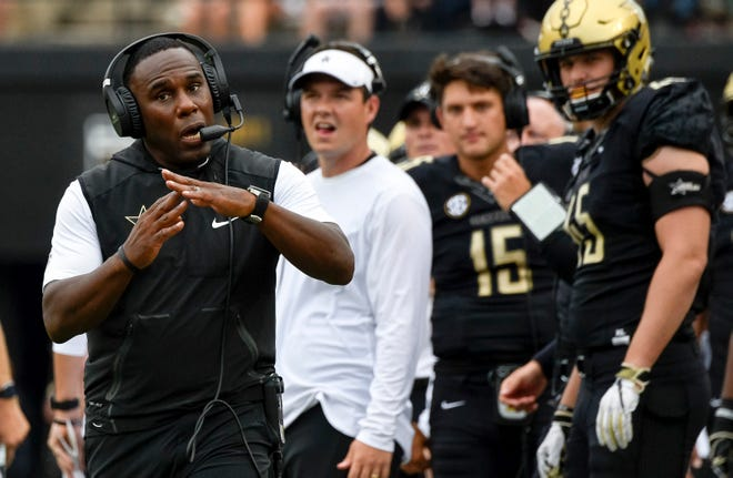 Vanderbilt coach Derek Mason challenges the call on what would later be ruled a touchdown scored by Vanderbilt wide receiver Kalija Lipscomb (not shown) during the first half against South Carolina on Saturday.