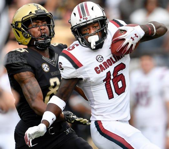 South Carolina defensive back Rashad Fenton (16) intercepts a pass intended for Vanderbilt wide receiver C.J. Bolar (83) during the first half at Vanderbilt University in Nashville, Tenn., Saturday, Sept. 22, 2018.