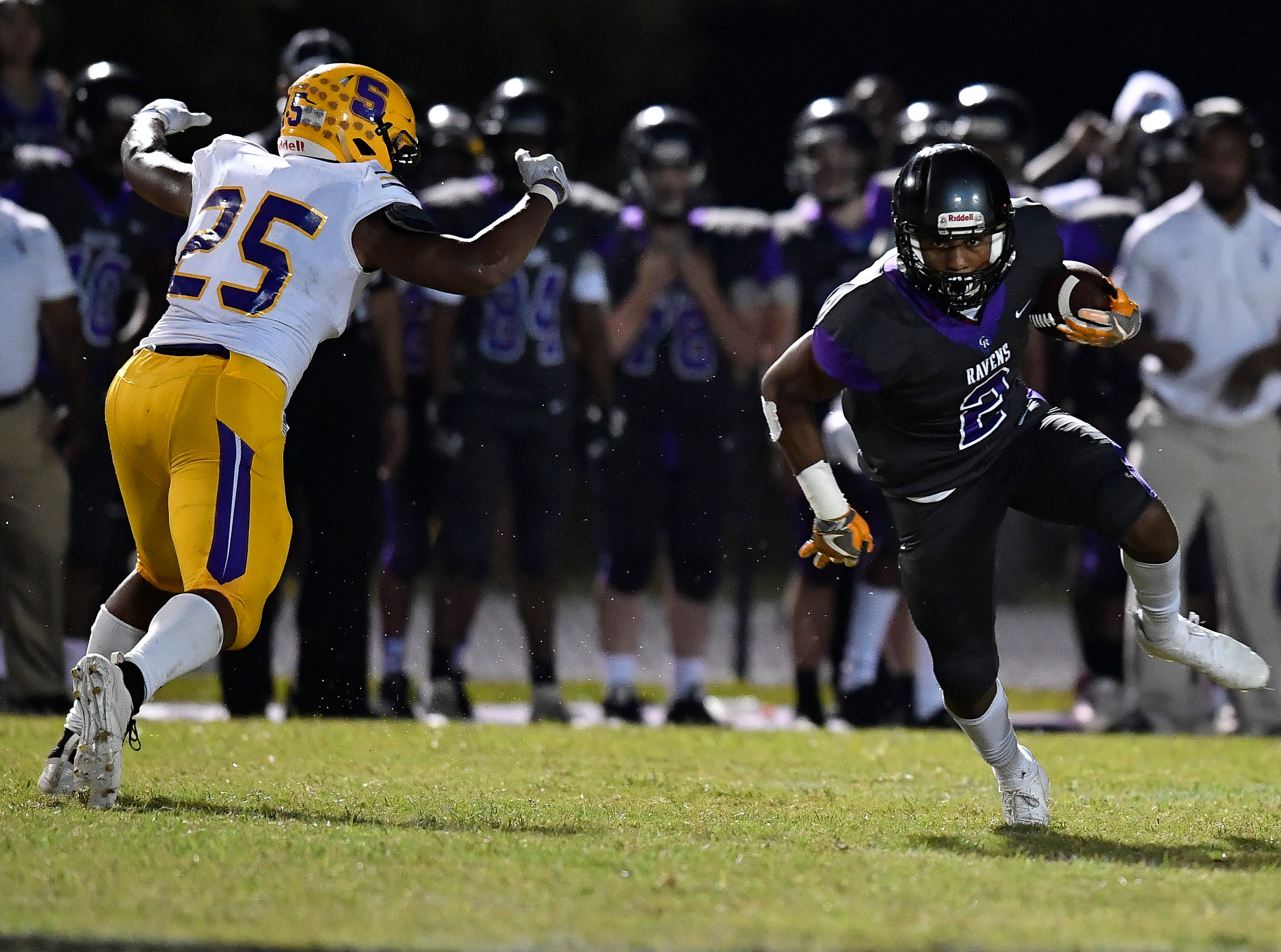 Cane Ridge wide receiver Quenton Barnes (2) pulls in a pass over Smyrna Josh Bailey (25) at Cane Ridge High School Friday, Sept. 21, 2018, in Nashville, Tenn.