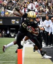 Vanderbilt wide receiver Kalija Lipscomb (16) is pushed out of bounds by South Carolina defensive back Steven Montac (22) during the first half at Vanderbilt University in Nashville, Tenn., Saturday, Sept. 22, 2018.