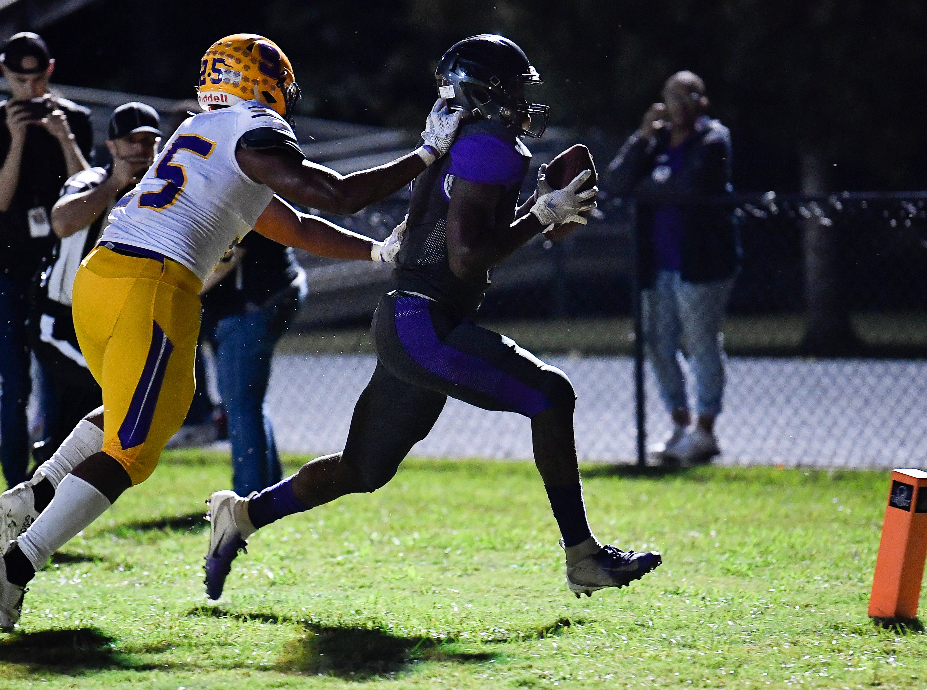 Cane Ridge Devon Starling (5) rushes in for a touchdown past Smyrna Josh Bailey (25) at Cane Ridge High School Friday, Sept. 21, 2018, in Nashville, Tenn.